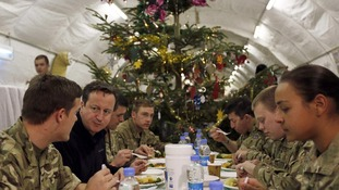 The Prime Minister enjoys an early Christmas dinner