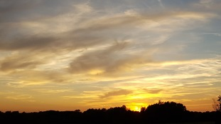 The sun setting over Great Chesterford in Essex on the hottest late August Bank Holiday on record.