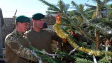 Marines decorate Christmas tree
