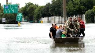 Residents are rescued from their homes