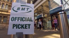 A picket at Lime Street during a strike in July.