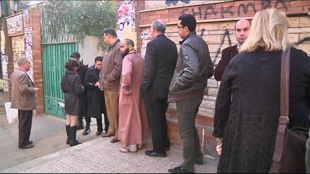 Egyptians queue outside a polling station