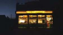 Shop with Tell the World sign