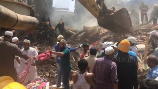 Several dead and dozens trapped as five-storey building collapses in flood-ravaged Mumbai