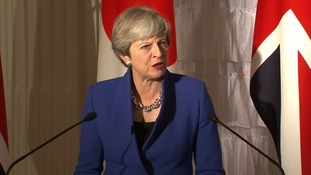 Theresa May speaks in Japan.