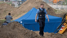 Officers at the site of the unexploded bomb