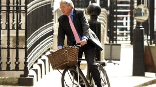 Andrew Mitchell pictured on his bike at Downing Street last year