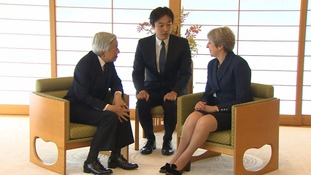 Theresa May met Japan's emperor (l) on Friday.