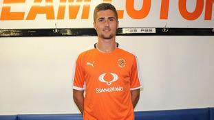 Aaron Jarvis signs his first professional contract with the Hatters