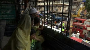 Amina Sheikh and her grandson watched the rescue efforts from a nearby apartment.