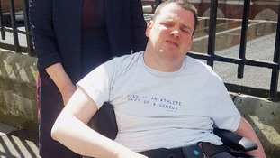 Severely disabled man Luke Davey outside the Royal Courts of Justice in London