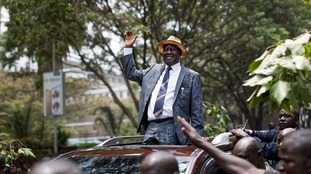 Opposition leader Raila Odinga celebrates as he leaves the Supreme Court in Nairobi