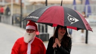 Paul Robinson, dressed as father Christmas and Rebecca Palmer, from Hull, shopping