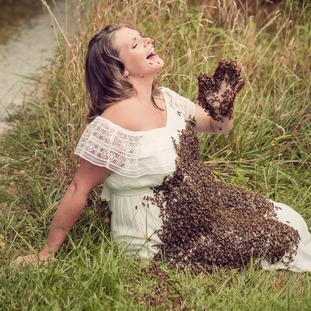 Emily Mueller poses with the bees