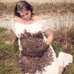 Emily Mueller with a belly of bees.