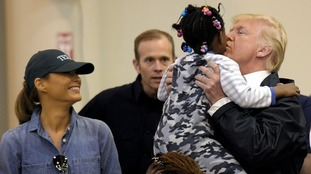 Donald and Melania Trump meet a child impacted by Hurricane Harvey.