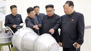 Kim Jong-un inspected the loading of a hydrogen bomb into a new intercontinental ballistic missile.