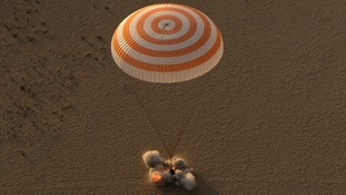 The capsule touches down in Kazakhstan.