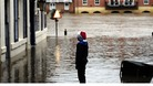 A young Christmas shopper looks at flood water in York city centre as heavy rain continues to cause problems across the UK.