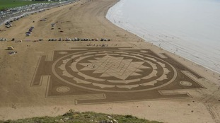 Sand artists transform Somerset beach