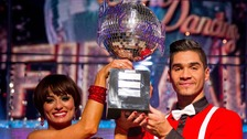Strictly winner Louis Smith and Flavia Cacace holding the glitterball trophy.