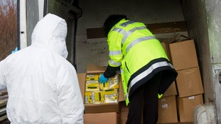 Revenue and Customs officers investigate illegal tobacco sit in UK earlier this year.
