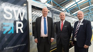 From left to right: Transport Secretary, Chris Grayling, Chief Executive of FirstGroup, Tim O'Toole and Managing Director of South Western Railway, Andy Mellors.