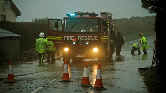 Fire and Rescue services work to clear a section of the A399 in North Devon.