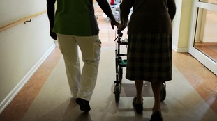Elderly patient and hospital worker