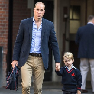 Prince Williams walks Prince George into school on his first day.