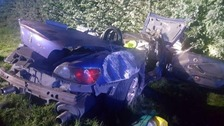 The driver was pulled from the car and taken to Burton Queen's hospital with non-threatening injuries.