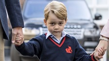Prince George pictured arriving at his new school today.