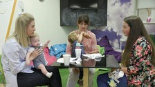 Terri Reid (right) talks to other mums about post-natal depression