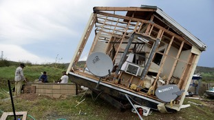 One man looks a what is left of his house in Puerto Rico.