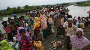 Rohingya Muslims wait to cross the Naf River into Bangladesh.