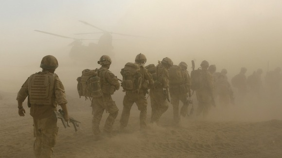 British soldiers boarding a Chinook helicopter in Helmand