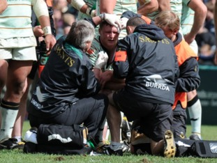 Chris Ashton had to receive treatment after the altercation with Manu Tuilagi.