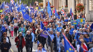 Anti-Brexit protesters make their way down Piccadilly.