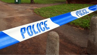 Knife held to child in robbery in Manchester