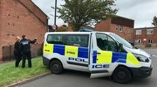 Police seal off the murder scene