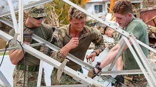 Royal Marines work with local police in Tortola following Hurricane Irma devastation