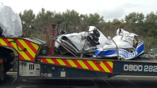The wreckage of the minibus in which eight people died on 26 August 2017.