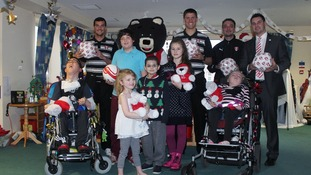 Footballers make festive visit to Bluebell Wood Children's Hospice