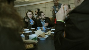Clients eat breakfast at this year's Crisis at Christmas shelter in London's Docklands.