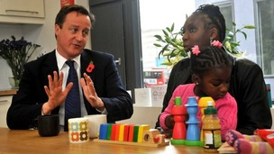 David Cameron with Karen McKellar and her adoptive daughter during a meeting in October