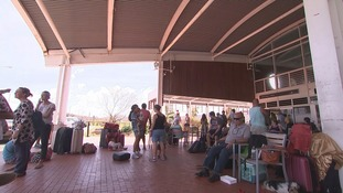 People take shelter at the airport on Beef Island.