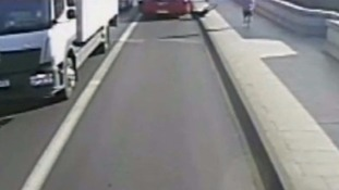 The woman came within inches of being hit by the London bus.