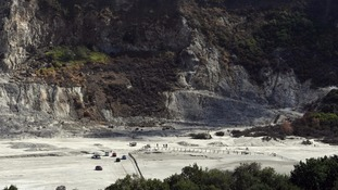Rescuers at the site where the family died at the Solfatara Crater.