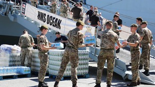 HMS Ocean departs Gibraltar for Caribbean with pallets of aid and pickup trucks