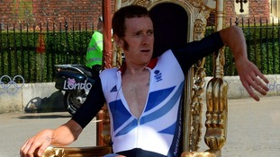 Bradley Wiggins sits on his throne after winning the Men's Individual Time Tria